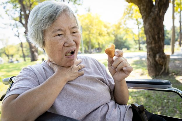 Asian,Senior,Woman,Suffers,From,Choke,And,Cough,clogged,Up,Food,elderly