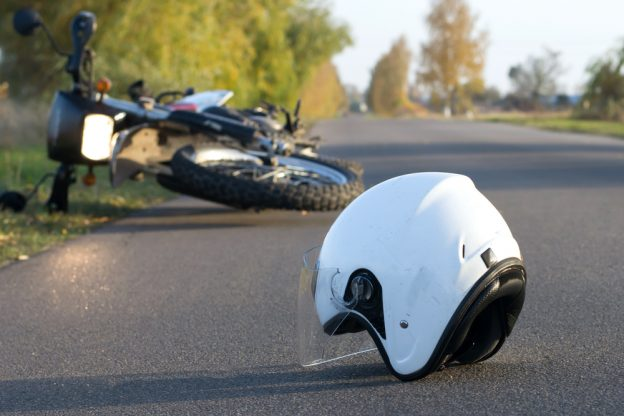 Photo,Of,Helmet,And,Motorcycle,On,Road,,The,Concept,Of